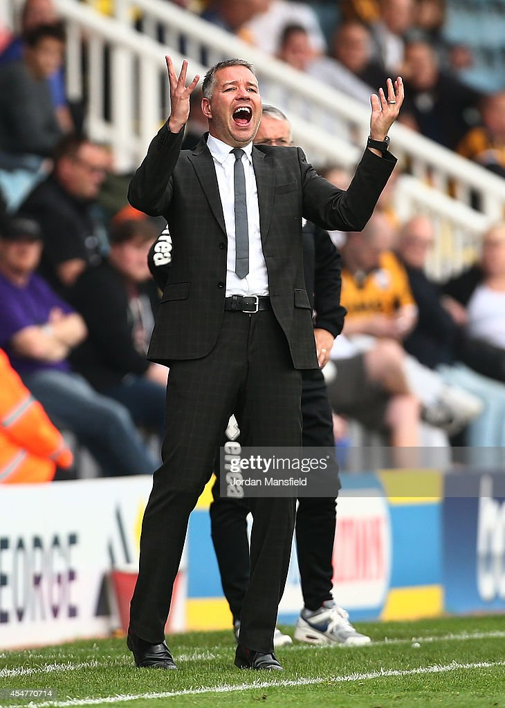 Darren Ferguson, the manager of Peterborough United gestures during the Sky Bet League One match between Peterborough United and Port Vale at London Road Stadium on September 6, 2014 in Peterborough, England.