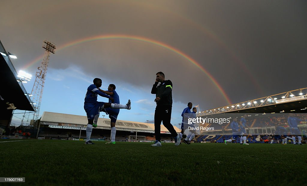 Darren Ferguson the Peterborough United manager watches his players warm up at half time underneath a rainbow during the pre season friendly match between Peterborough United and Hull City at London Road Stadium on July 29, 2013 in Peterborough, England.