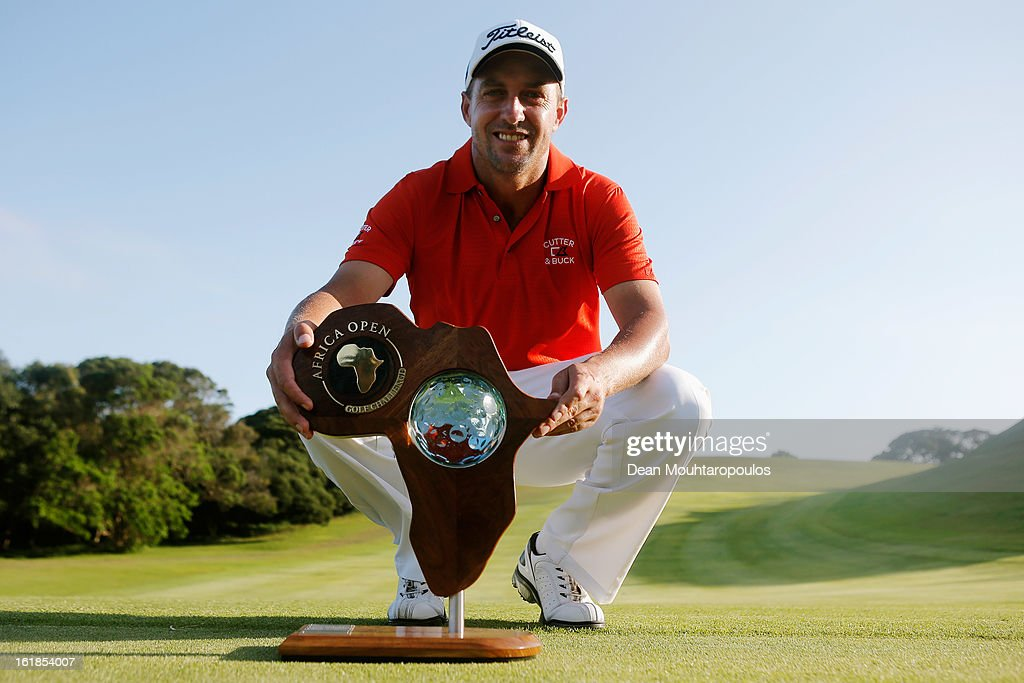 Darren Fichardt of South Africa celebrates with the trophy after he wins the Africa Open at East London Golf Club on February 17, 2013 in East London, South Africa.