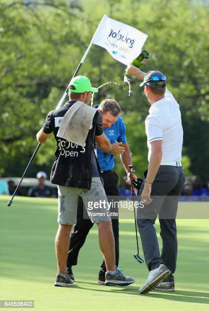 Darren Fichardt of South Africa is congratulated by fellow South African golfer Brandon Stone after winning the Joburg Open at Royal Johannesburg and...
