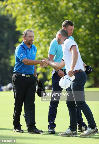 Darren Fichardt of South Africa is congratulated by Paul Waring of England after winning the Joburg Open at Royal Johannesburg and Kensington Golf...