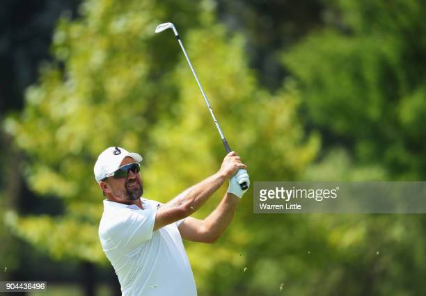 Darren Fichardt of South Africa plays his second shot on the 18th hole during day three of the BMW South African Open Championship at Glendower Golf...