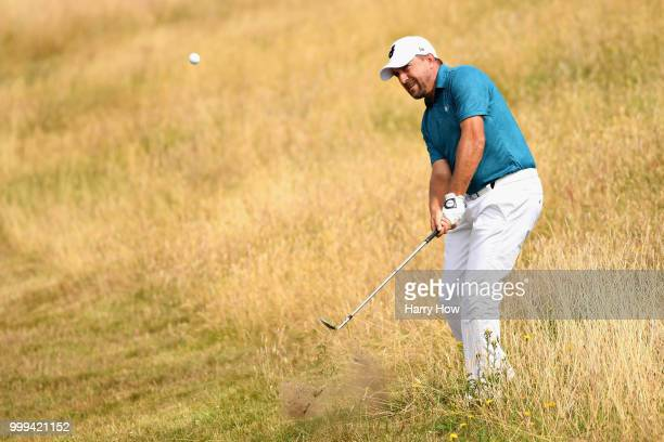Darren Fichardt of South Africa plays out of the rough on hole one during day four of the Aberdeen Standard Investments Scottish Open at Gullane Golf...