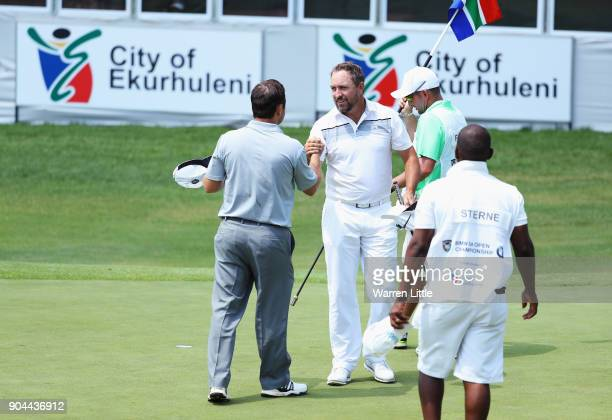 Darren Fichardt of South Africa shakes hands with Richard Sterne of South Africa on the 18th green during day three of the BMW South African Open...