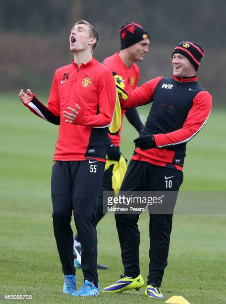 Darren Fletcher and Wayne Rooney of Manchester United in action during a first team training session, ahead of their UEFA Champions League Group A...