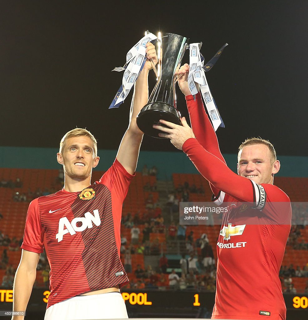 Darren Fletcher and Wayne Rooney of Manchester United lift the International Champions Cup trophy after the pre-season friendly match between Manchester United and Liverpool at Sun Life Stadium on August 4, 2014 in Miami Gardens, Florida.