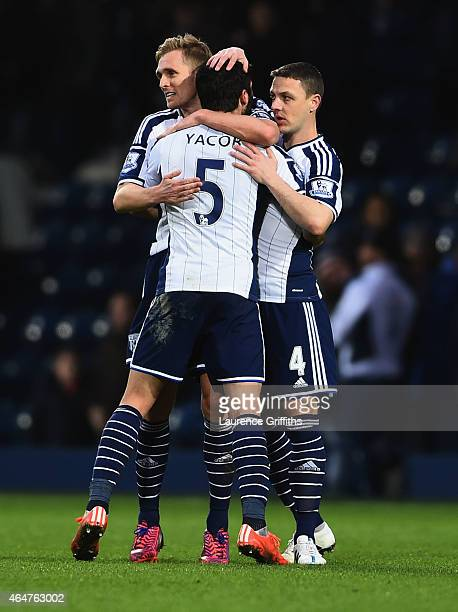 Darren Fletcher Claudio Yacob and Chris Baird of West Bromwich Albion celebrate after victory in the Barclays Premier League match between West...