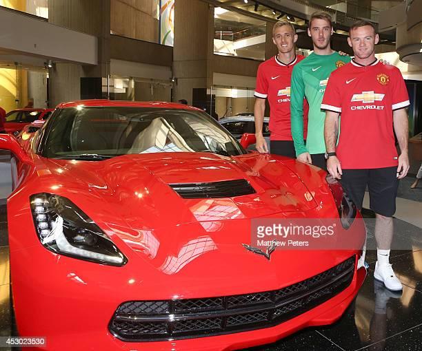 Darren Fletcher David de Gea and Wayne Rooney of Manchester United visit the headquarters of General Motors on August 1 2014 in Detroit Michigan