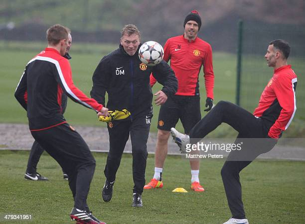 Darren Fletcher Manager David Moyes and Ryan Giggs of Manchester United in action during a first team training session ahead of their UEFA Champions...