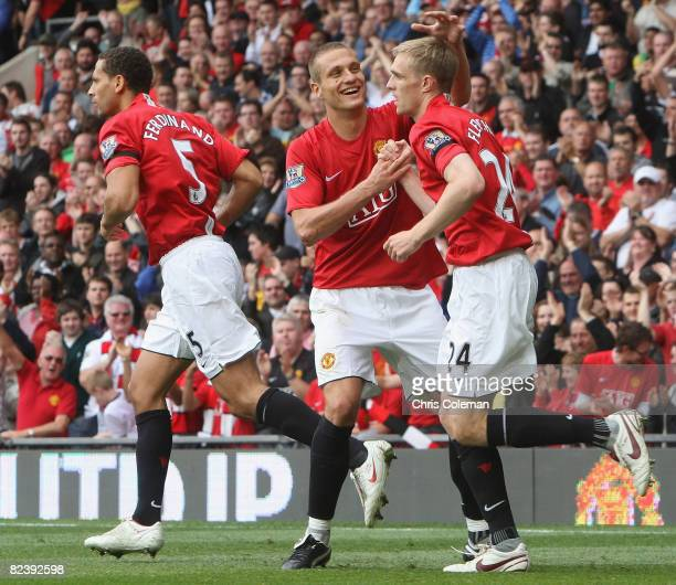 Darren Fletcher of Manchester United celebrates scoring their first goal with Nemanja Vidic during the FA Premier League match between Manchester...