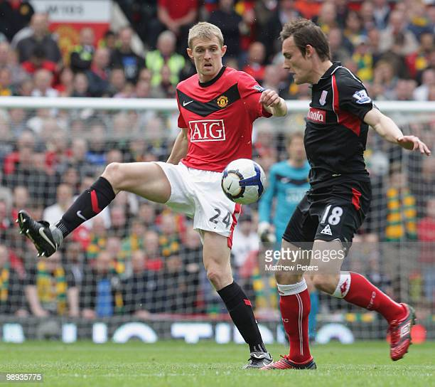 Darren Fletcher of Manchester United clashes with Dean Whitehead of Stoke City during the Barclays Premier League match between Manchester United and...