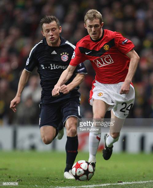 Darren Fletcher of Manchester United clashes with Ivica Olic of Bayern Munich during the UEFA Champions League QuarterFinal Second Leg match between...
