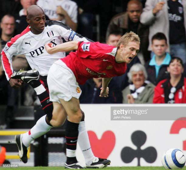 Darren Fletcher of Manchester United clashes with Luis Boa Morte of Fulham during the Barclays Premiership match between Fulham and Manchester United...