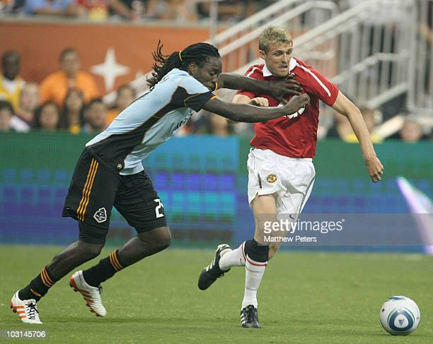 Darren Fletcher of Manchester United clashes with Shalrie Joseph of MLS Allstars during the MLS AllStar match between Manchester United and MLS...