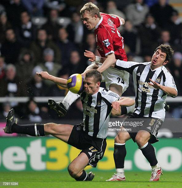 Darren Fletcher of Manchester United is challenged by Scott Parker and Emre of Newcastle United during the Barclays Premiership match between...