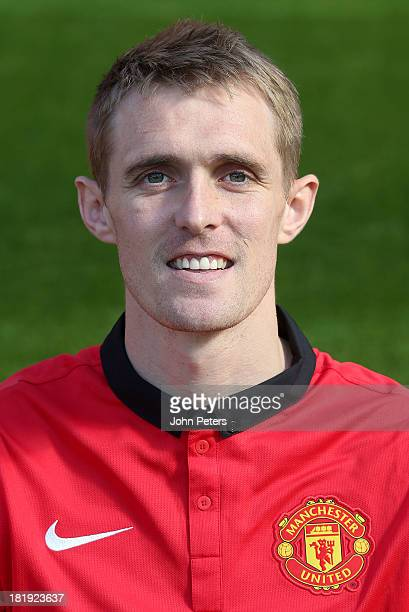 Darren Fletcher of Manchester United poses at the annual club photocall at Old Trafford on September 26 2013 in Manchester England