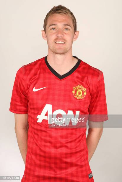 Darren Fletcher of Manchester United poses during a photocall at Carrington Training Ground on August 21 2012 in Manchester England