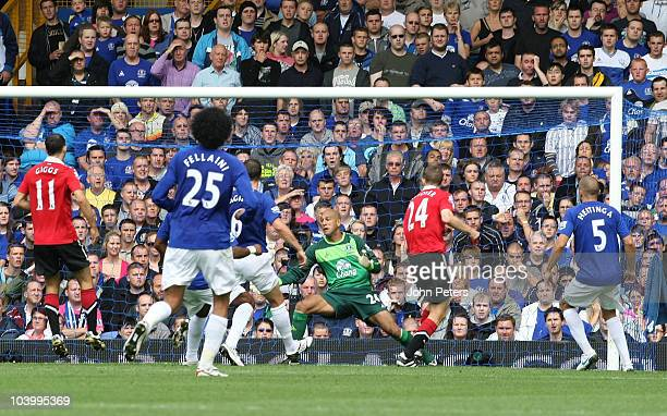 Darren Fletcher of Manchester United scores their first goal during the Barclays Premier League match between Everton and Manchester United at...