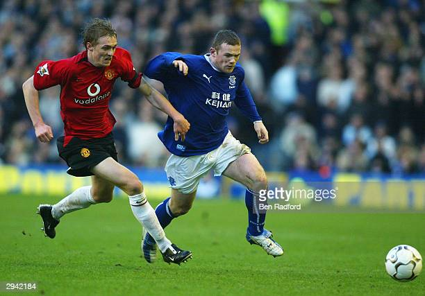 Darren Fletcher of Manchester United tackles Wayne Rooney of Everton during the FA Barclaycard Premiership match between Everton and Manchester...
