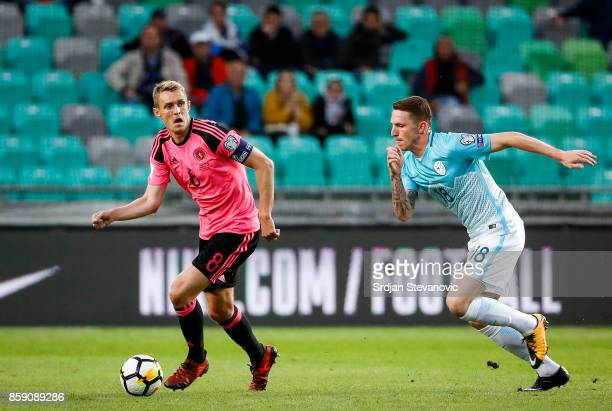 Darren Fletcher of Scotland in action against Rajko Rotman of Slovenia during the FIFA 2018 World Cup Qualifier match between Slovenia and Scotland...
