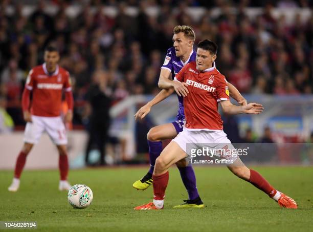 Darren Fletcher of Stoke City battles with Joe Lolley of Nottingham Forest during the Carabao Cup Third Round match between Nottingham Forest and...