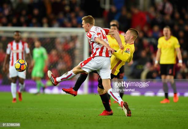 Darren Fletcher of Stoke City tackles Gerard Deulofeu of Watford during the Premier League match between Stoke City and Watford at Bet365 Stadium on...
