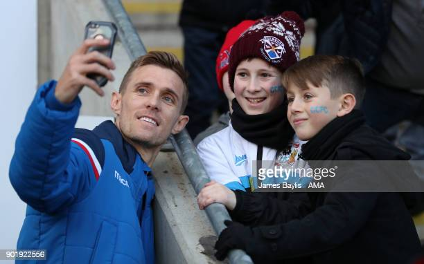 Darren Fletcher of Stoke City takes a selfie with two young Coventry City supporters before The Emirates FA Cup Third match between Coventry City and...