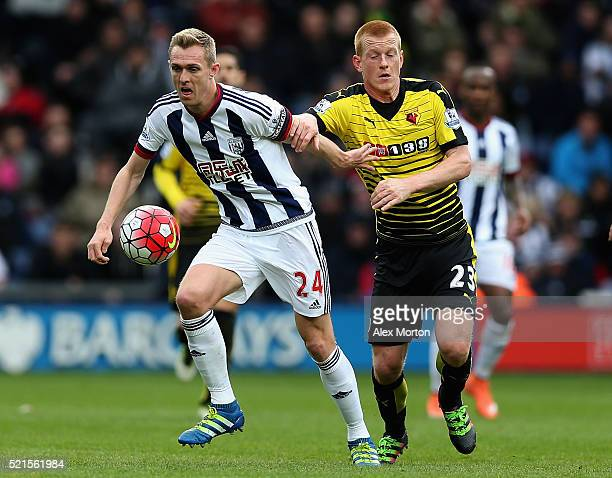 Darren Fletcher of West Bromwich Albion and Ben Watson of Watford challenge for possesion during the Barclays Premier League match between West...