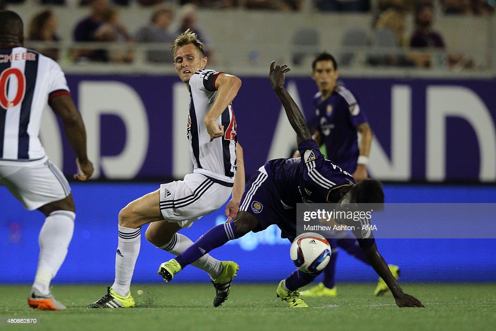 Darren Fletcher of West Bromwich Albion and Estrela of Orlando City during the pre-season friendly between Orlando City and West Bromwich Albion at Orlando Citrus Bowl on July 15, 2015 in Orlando, Florida.