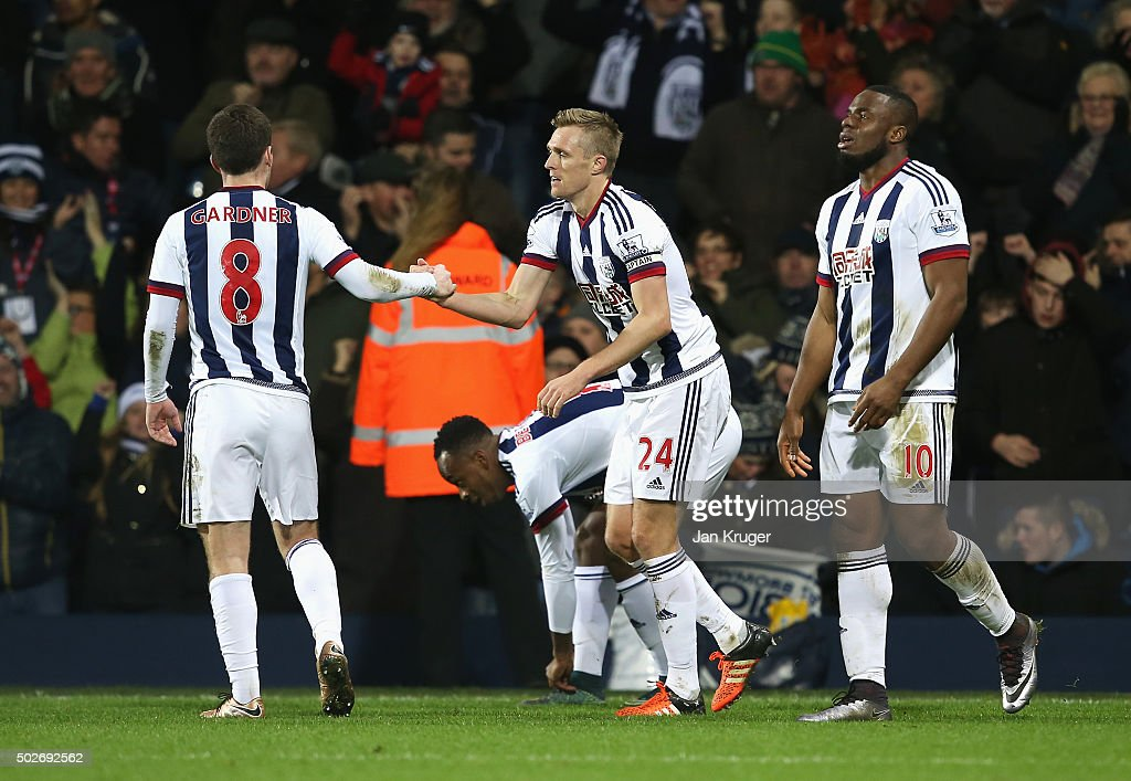 Darren Fletcher (C) of West Bromwich Albion celebrates scoring his team's first goal with his team mates during the Barclays Premier League match between West Bromwich Albion and Newcastle United at The Hawthorns on December 28, 2015 in West Bromwich, England.