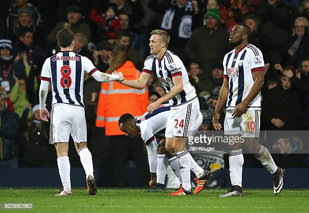 Darren Fletcher of West Bromwich Albion celebrates scoring his team's first goal with his team mates during the Barclays Premier League match between...