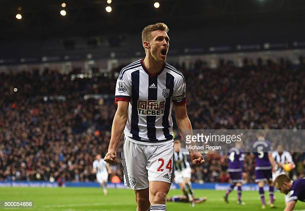 Darren Fletcher of West Bromwich Albion celebrates setting up his team's first goal by James McClean during the Barclays Premier League match between...