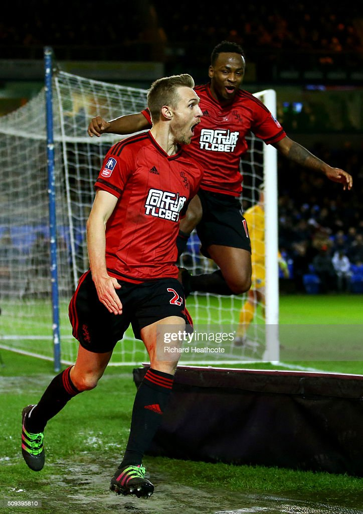 Darren Fletcher of West Bromwich Albion celebrates with team-mate Saido Berahino after scoring his team's first goal during the Emirates FA Cup fourth round replay match between Peterborough United and West Bromwich Albion at ABAX Stadium on February 10, 2016 in Peterborough, England.