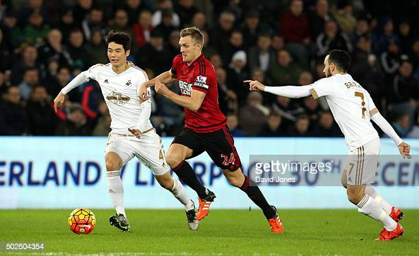Darren Fletcher of West Bromwich Albion challenges Ki SungYueng and Leon Britton of Swansea City during the Barclay's Premier League match between...