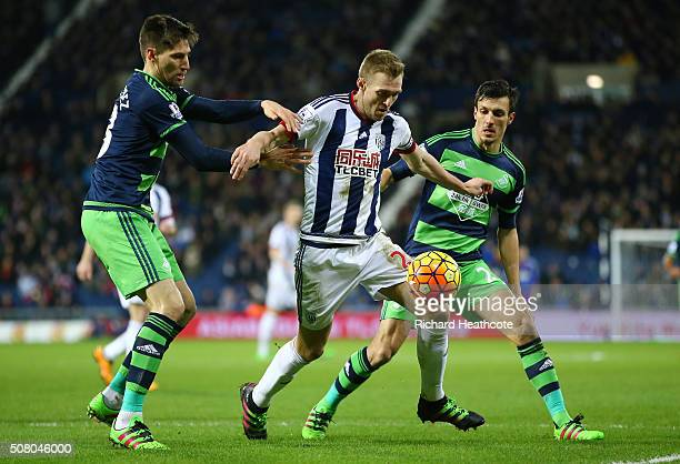 Darren Fletcher of West Bromwich Albion controls the ball under pressure of Federico Fernandez and Jack Cork of Swansea City during the Barclays...