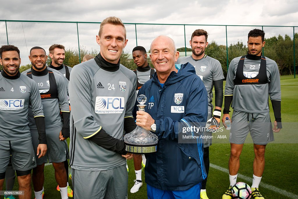 Darren Fletcher of West Bromwich Albion presents Head Coach Tony Pulis with a Ship's Decanter to commemorate his 1000th match as a manager at West Bromwich Albion Training Ground on September 23, 2016 in Walsall, England.