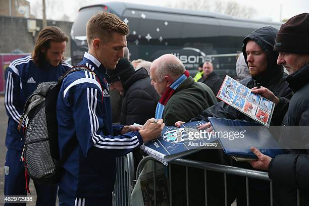 Darren Fletcher of West Bromwich Albion signs autographs as the team arrive prior to the Barclays Premier League match between Burnley and West...