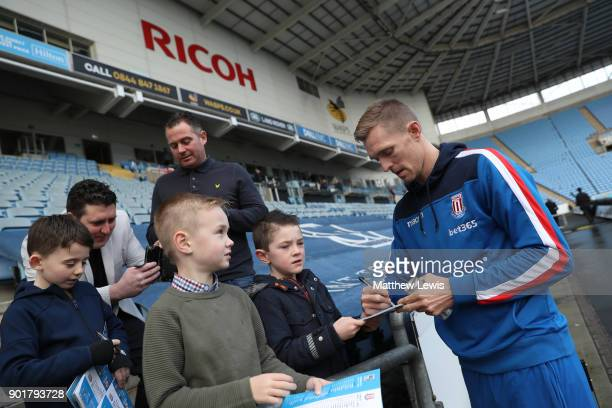 Darren Fletcher of West Bromwich Albion signs autographs for fans prior to The Emirates FA Cup Third Round match between Coventry City and Stoke City...