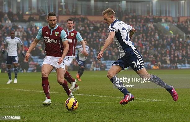 Darren Fletcher of West Bromwich Albion takes on Jason Shackell of Burnley during the Barclays Premier League match between Burnley and West Bromwich...