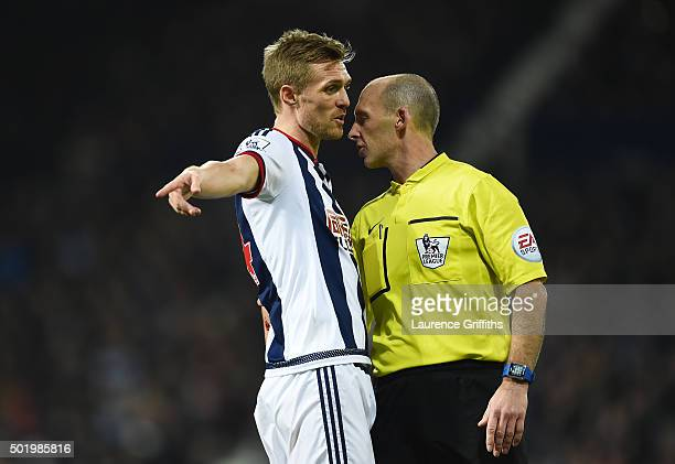 Darren Fletcher of West Bromwich Albion talks with referee Mike Dean during the Barclays Premier League match between West Bromwich Albion and AFC...