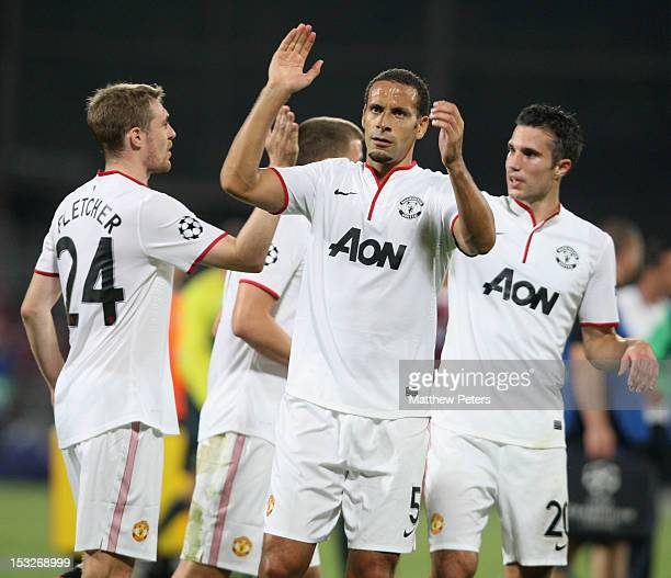 Darren Fletcher Rio Ferdinand and Robin van Persie of Manchester United celebrate at final whistle during the UEFA Champions League Group H match...