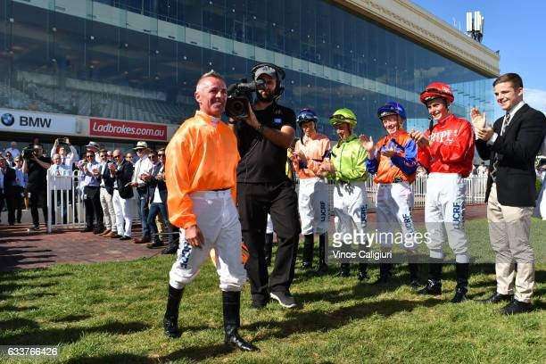 Darren Gauci is receives a guard of honour from his family friends and fellow jockeys before his last career ride in Race 9 at Caulfield Racecourse...