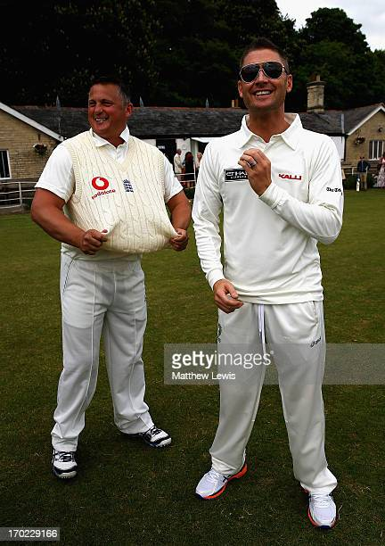 Darren Gough and Michael Clarke talk during the Shane Warne's Australia vs Michael Vaughan's England T20 match at Circenster Cricket Club on June 9...