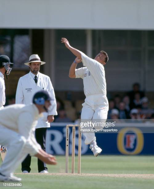 Darren Gough bowling for England during the 1st Test match between England and Australia at Edgbaston, Birmingham, 8th June 1997. The umpire is Peter...