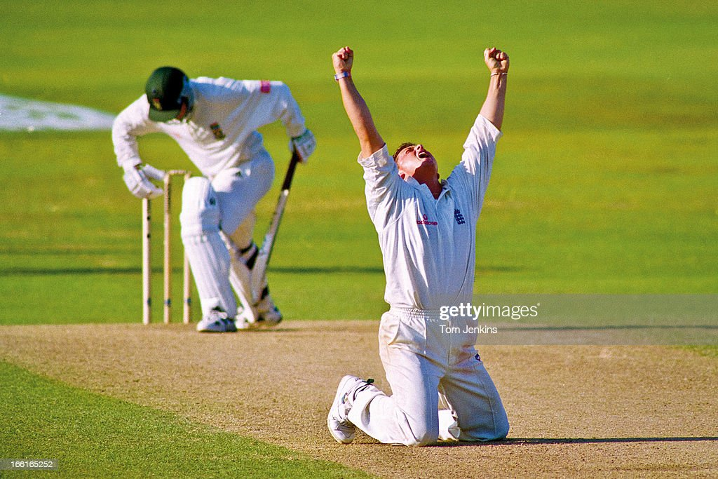 Darren Gough of England (centre) celebrates taking the wicket of Mark Boucher (left) thus achieving his 5th wicket of the South African 2nd innings during the 5th test match England versus South Africa at the Headingley cricket ground on August 9th 1998 in Leeds, West Yorkshire (Photo by Tom Jenkins/Getty Images). An image from the book 'In The Moment' published June 2012