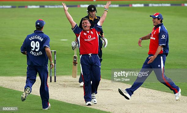 Darren Gough of England celebrates with Michael Vaughan and kevin Pietersen after taking the wicket of Chris Denham of Hampshire to complete his hat...