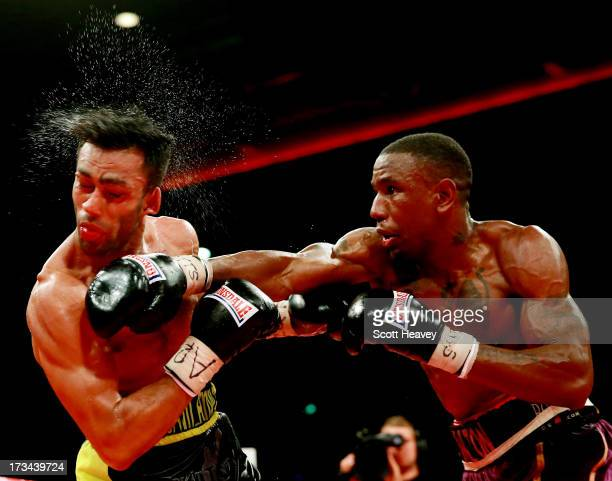 Darren Hamilton connects with Adil Anwar during their British Light Welterweight Title Fight on July 6 2013 in Liverpool England