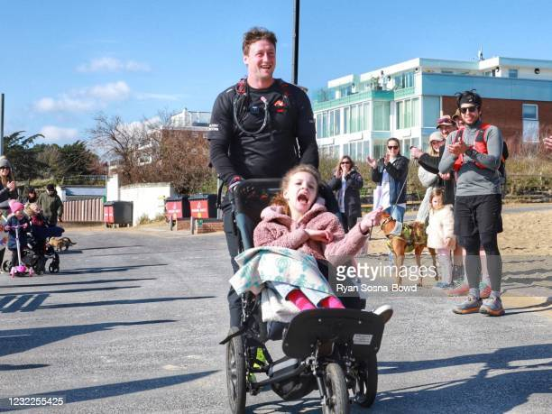 Darren Hardy pictured with Aggie Candy-Waters completes his 5 marathons in 50 hours on April 9, 2021 in Poole, England. Darren Hardy pledged to help...