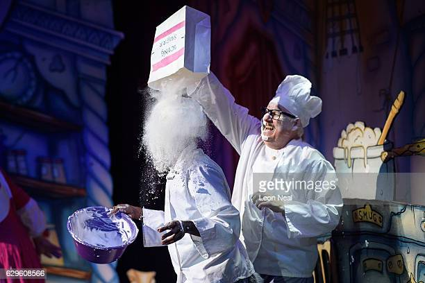Darren Hart is covered with flour by Tony Whittle during a performance of the traditional pantomime Sleeping Beauty at the Hackney Empire on December...