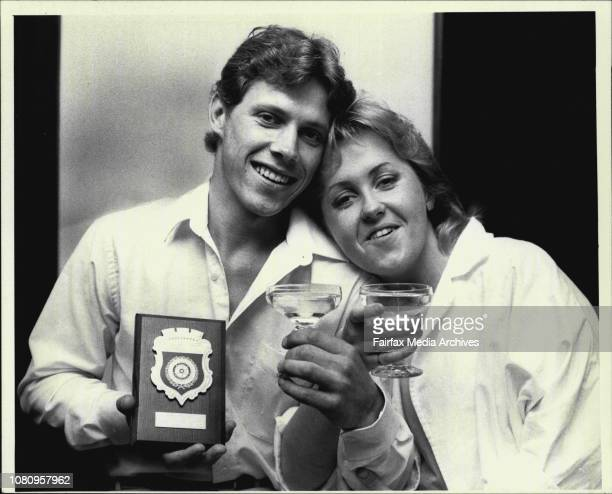 Darren Hartley a 22yr old deaf Tiler shares a congratulatory drink with his girl friend 19yrd old Brownwyn Pageh after winning a Pride of Workmanship...